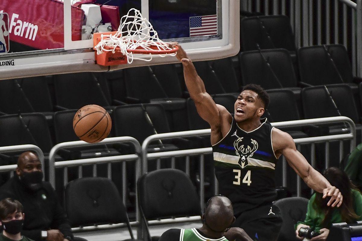 Milwaukee Bucks forward Giannis Antetokounmpo (34) dunks a basket against Boston Celtics center Tacko Fall (99) in the second quarter at Fiserv Forum.