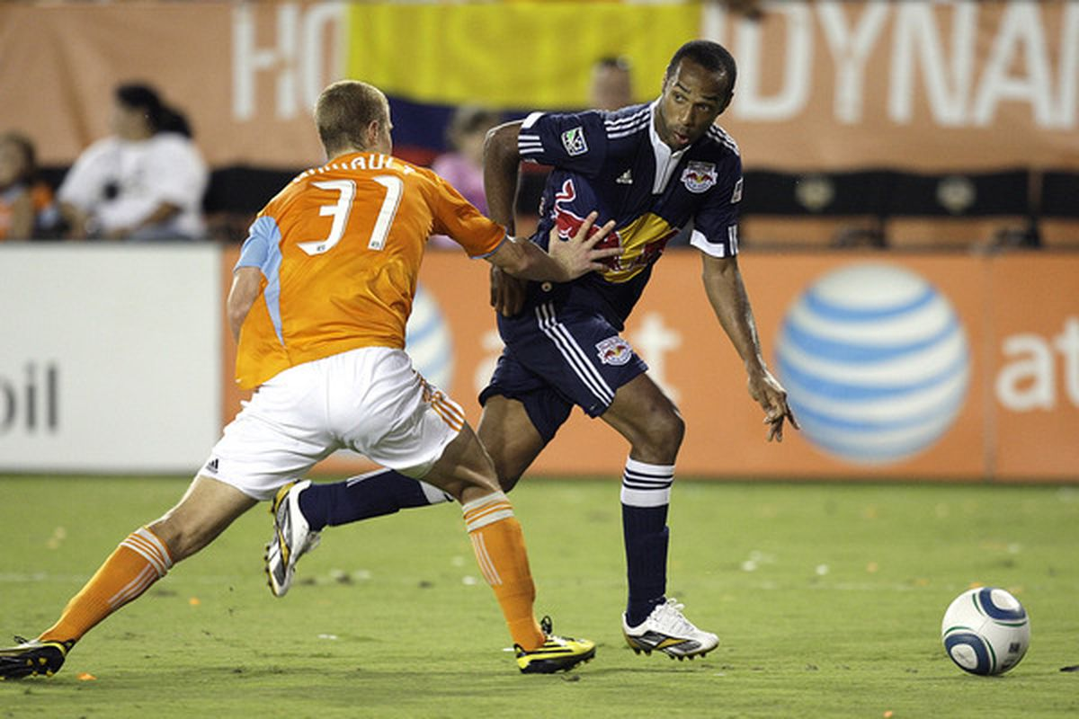 HOUSTON - JULY 31:  Thierry Henry #14 of the New York Red Bulls drives past Andrew Hainult #31 of the Houston Dynamo in the second half at Robertson Stadium on July 31 2010 in Houston Texas.  (Photo by Bob Levey/Getty Images)