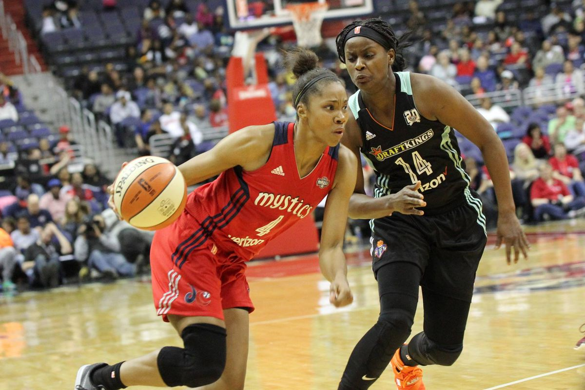 Tayler Hill of the Washington Mystics dribbles the ball against Sugar Rodgers of the New York Liberty