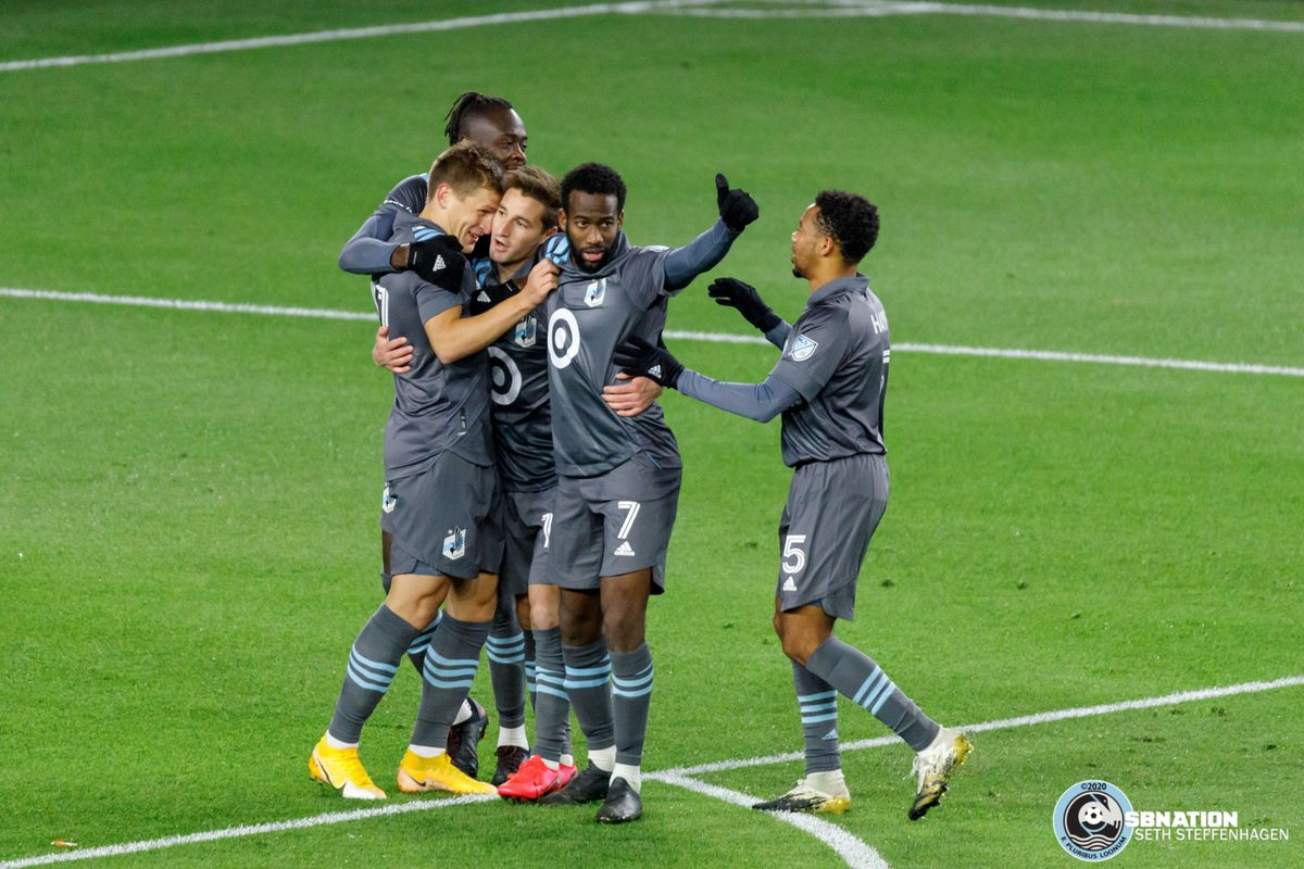 October 18, 2020 - Saint Paul, Minnesota, United States - Minnesota United midfielder Ethan Finlay (13) celebrates with his team after scoring the first goal during the match against the Houston Dynamo at Allianz Field.
