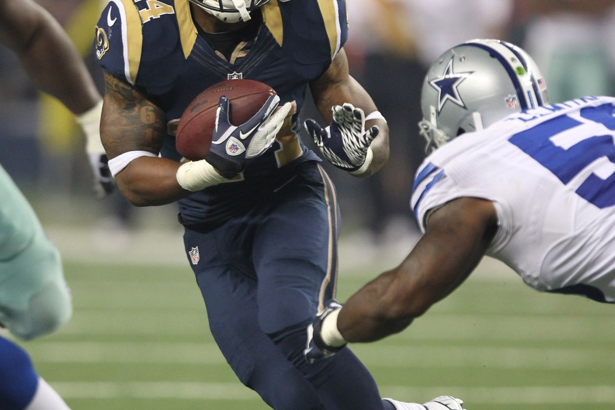 Aug 25, 2012; Arlington, TX, USA; St Louis Rams running back Isaiah Pead (24) runs after a catch in the third quarter against the Dallas Cowboys at Cowboys Stadium. The Cowboys beat the Rams 20-19. Mandatory Credit: Matthew Emmons-US PRESSWIRE