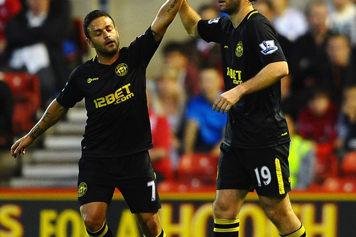 Mauro Boselli of Wigan celebrates scoring with Albert Crusat during the Capital One Cup second round match between Nottingham Forest and Wigan Athletic at City Ground.