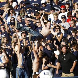 Utah State University fans enjoy the warm autumn sun of Cache valley as they watch their Aggies play against Utah at Romney Stadium in Logan, Utah Saturday Sept. 13, 2008. August MIller/ Deseret News