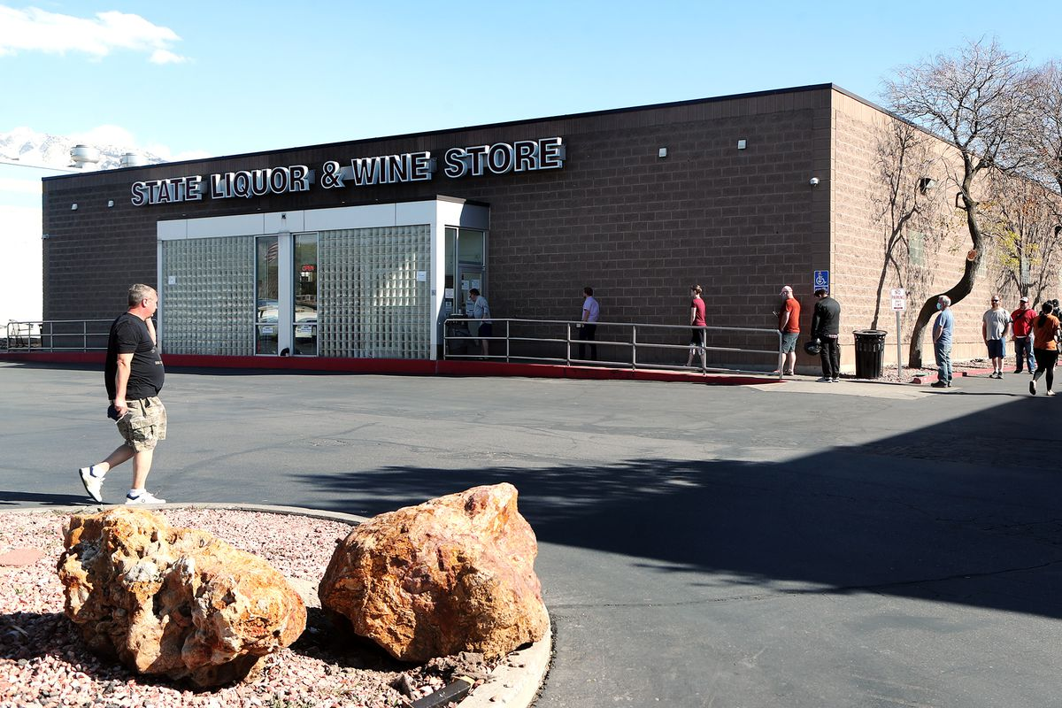 Customers line up outside of the Utah State Liquor and Wine store in Sandy on Tuesday, April 21, 2020.