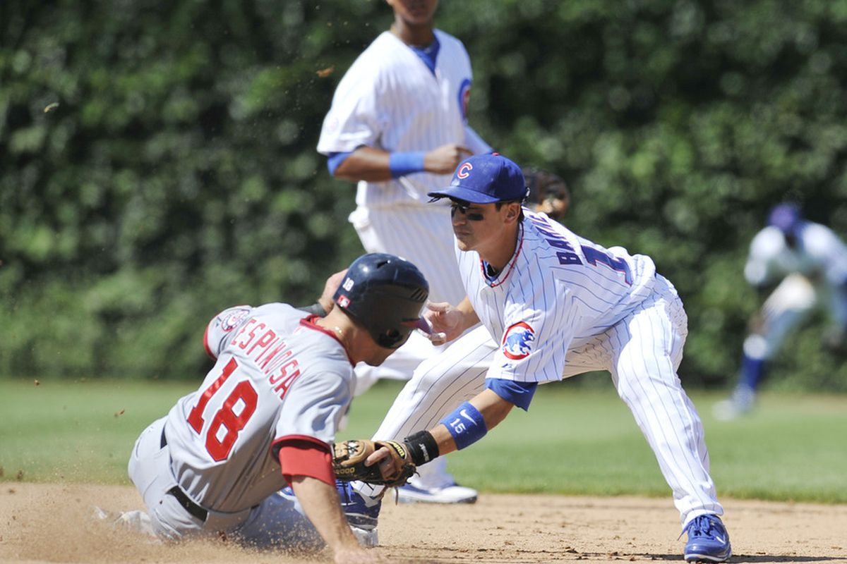 Danny Espinosa of the Washington Nationals is tagged out at second base by Darwin Barney of the Chicago Cubs at Wrigley Field in Chicago, Illinois. The cubs defeated the Nationals 4-3.  (Photo by David Banks/Getty Images)