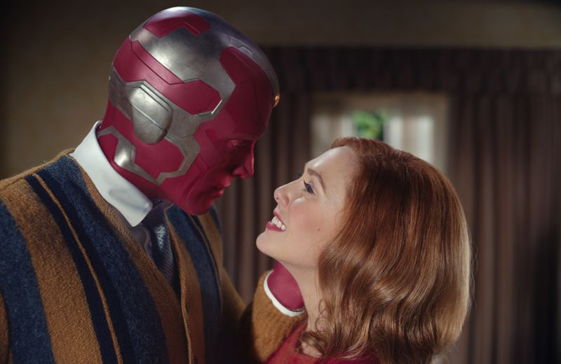 In a world reminiscent of 1970s sitcoms, Vision goes in for a kiss as Wanda beams up at him.