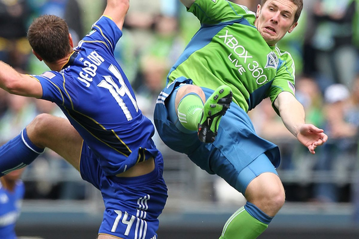 SEATTLE - APRIL 17:  Michael Fucito #2 of the Seattle Sounders FC  battles Jack Jewsbury #14 of the Kansas City Wizards on April 17, 2010 at Qwest Field in Seattle, Washington. (Photo by Otto Greule Jr/Getty Images)