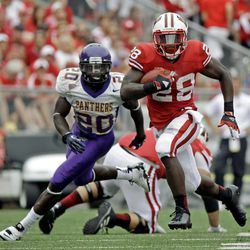 Wisconsin's Montee Ball (28) breaks away from Northern Iowa's Wilmot Wellington (20) for a 16-yard pass reception during the second half of an NCAA college football game Saturday, Sept. 1, 2012, in Madison, Wis. Wisconsin won 26-21.