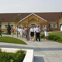 Tour group moves from the neighboring meetinghouse to the Kyiv Ukraine Temple during open house. August 2010.