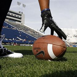 The teams warm up before Brigham Young University faces Idaho State in NCAA football in Provo, Saturday, Oct. 22, 2011.