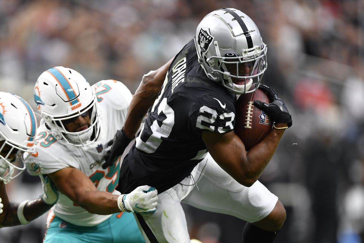 Running back Kenyan Drake #23 of the Las Vegas Raiders runs against the Miami Dolphins during the second half of a game at Allegiant Stadium on September 26, 2021 in Las Vegas, Nevada.