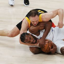 Utah Jazz forward Bojan Bogdanovic (44) and LA Clippers forward Kawhi Leonard (2) fight for the ball during the NBA playoffs in Salt Lake City on Thursday, June 10, 2021. The Jazz won 117-111.