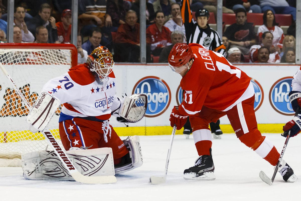 March 19, 2012; Detroit, MI, USA; Detroit Red Wings right wing Danny Cleary (11) tries to score on Washington Capitals goalie Braden Holtby (70) in the first period at Joe Louis Arena. Mandatory Credit: Rick Osentoski-US PRESSWIRE