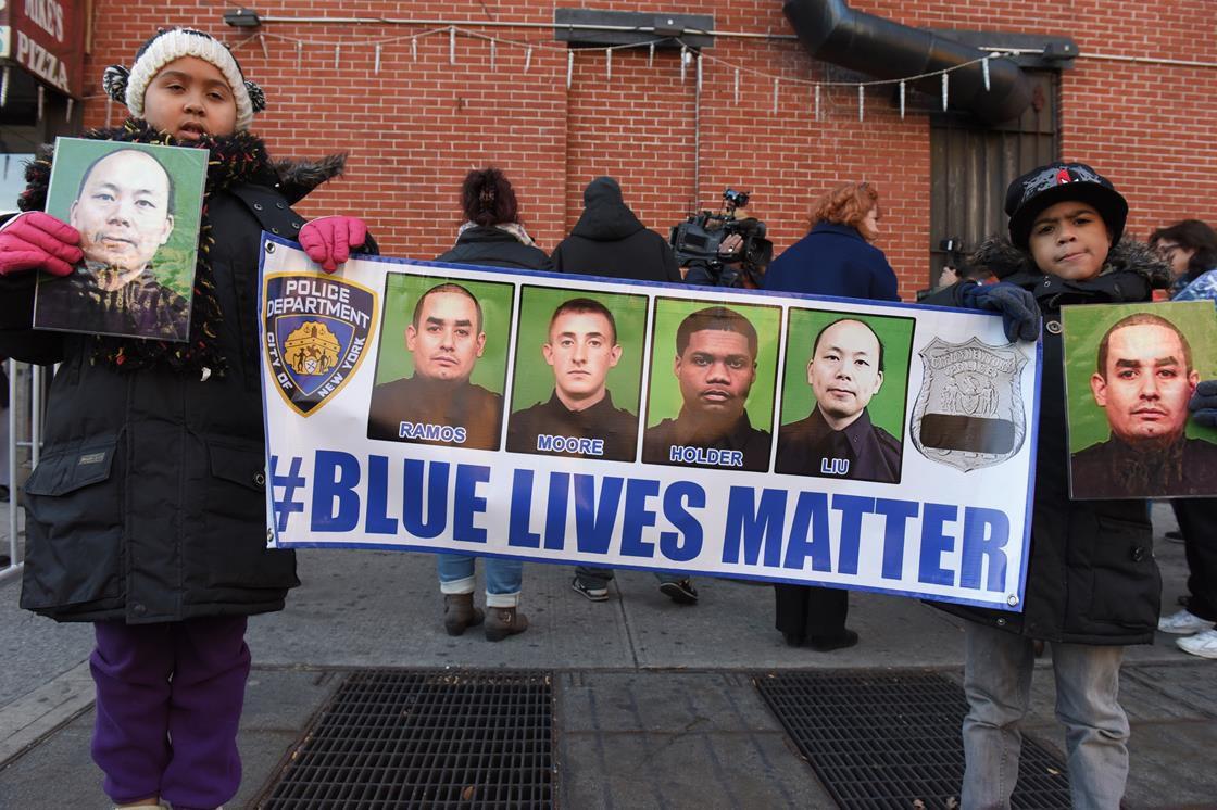 Kids holding a Blue Lives Matter banner