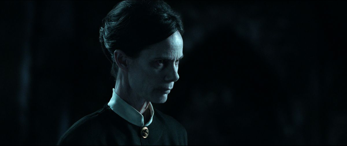 The Conjuring: The Devil Made Me Do It's calm blue light with a stern look