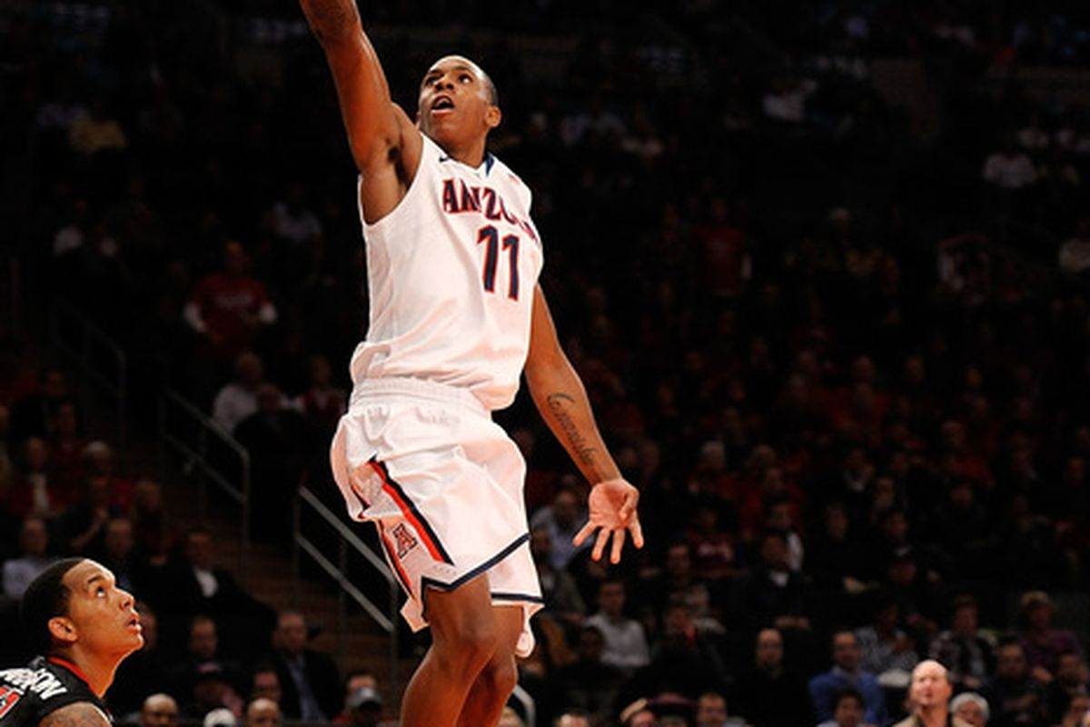 Josiah Turner during the 2KSports Classic at Madison Square Garden, scoring as D`Angelo Harrison watches.