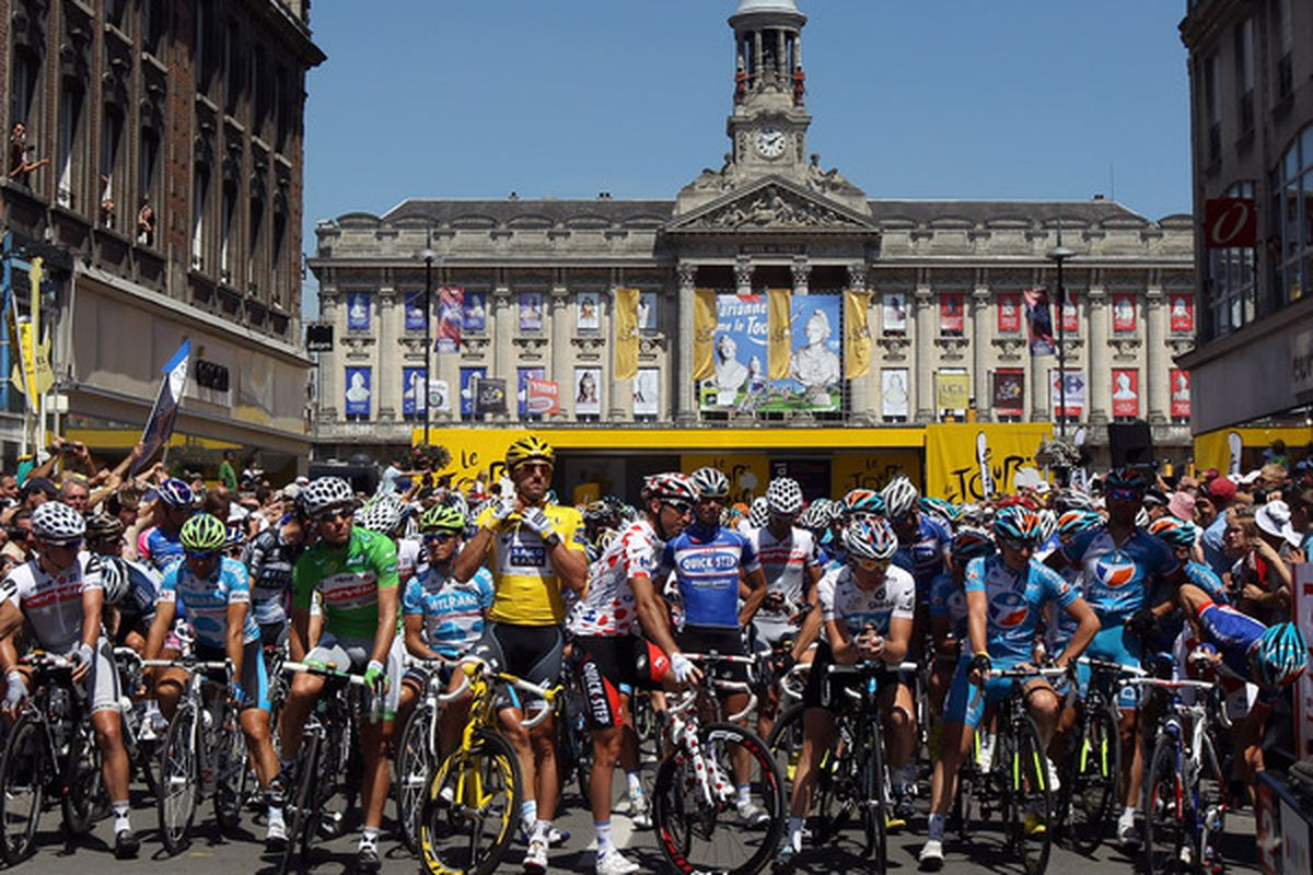 CAMBRAI FRANCE - JULY 07:  The riders prepare for the start of stage four of the 2010 Tour de France from Cambrai to Reims on July 7 2010 in Cambrai France.  (Photo by Bryn Lennon/Getty Images)