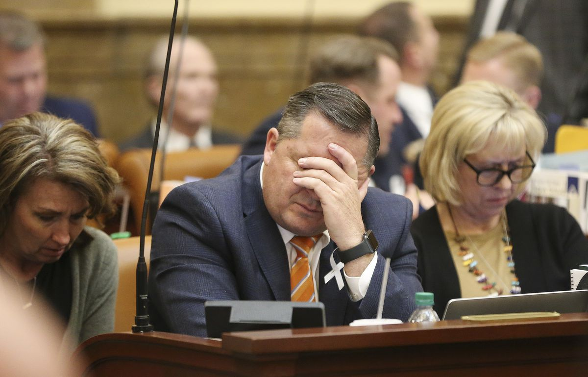Rep. Derrin Owens, R-Fountain Green, rubs his eyes during the last night of the 2020 legislative sessionat the Capitol in Salt Lake City on Thursday, March 12, 2020.