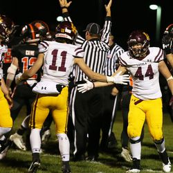Loyola's Mike Gavric (44) gets a little love from Artie Collins (11).  Allen Cunningham/For the Sun-Times.