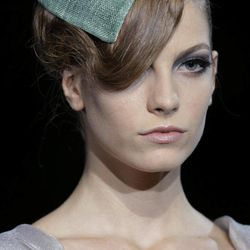 A model wears a creation part of the Giorgio Armani women's Spring-Summer 2013 collection that was presented in Milan, Italy, Sunday, Sept. 23, 2012.