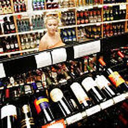 Erin Atwater chooses a bottle of wine in a state liquor store in Salt Lake City. Wine sales have risen 63 percent in a decade.