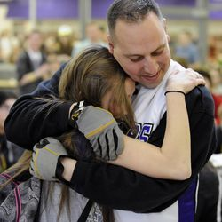Bailee Goettig hugs her father, Air Force Tech Sgt. Edward Goettig, who surprised her with his early return at Lehi High School on Thursday, March 6, 2014. Goettig had been deployed to Afghanistan since Aug. 27, 2013.