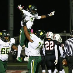 Waubonsie Valley's Bryce Logan (7) gets a lift from Chris Carter (74). Allen Cunningham/For the Sun-Times.