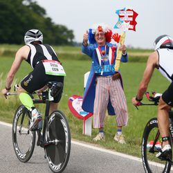 A fan cheers during the Challenge Roth on July 20, 2014 in Roth, Germany. (Photo by Alex Grimm/Getty Images)