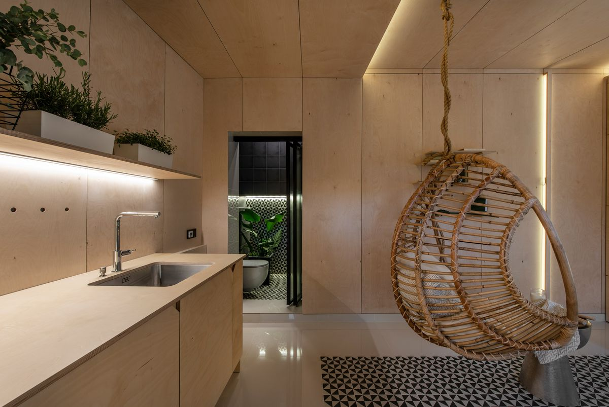 Bamboo chair dangling from ceiling