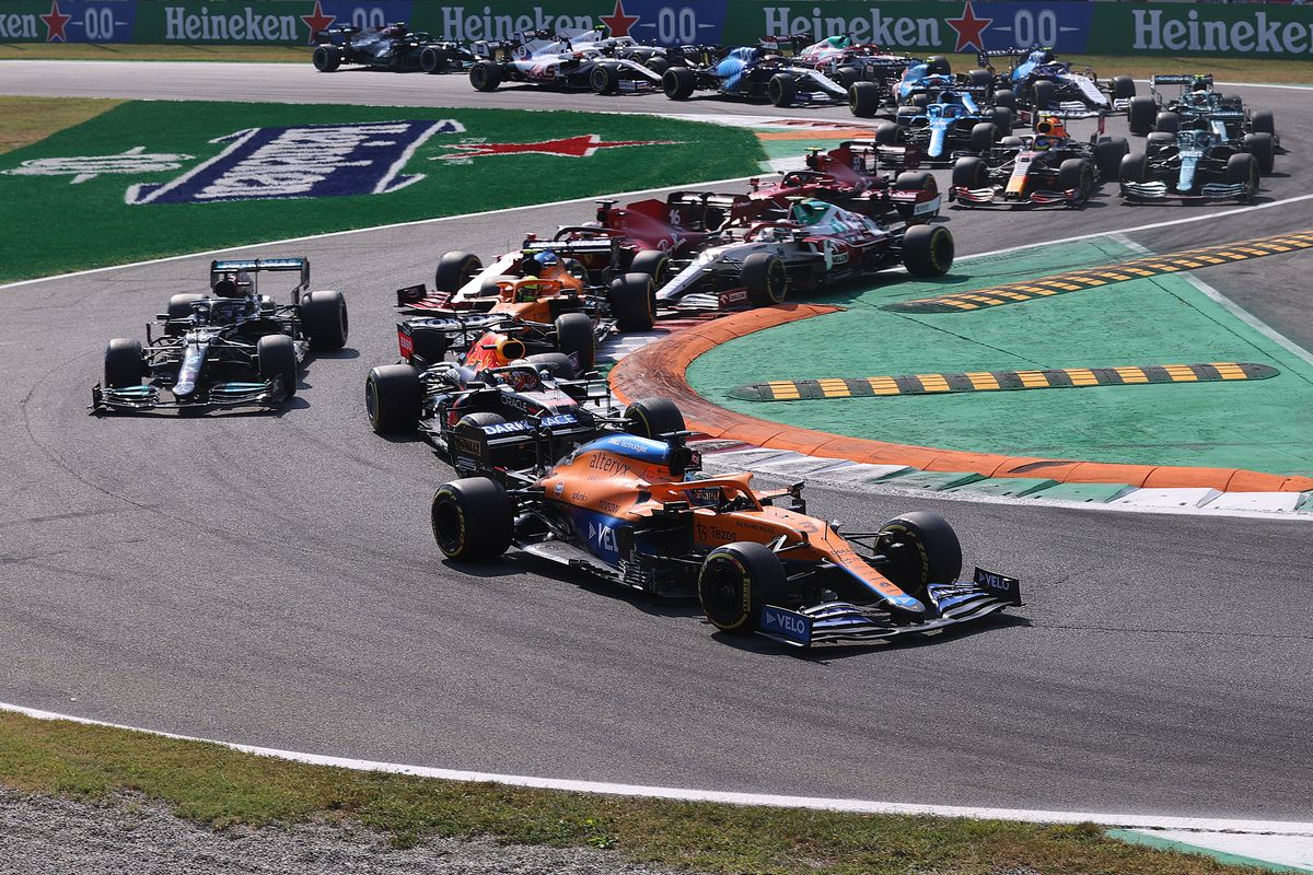 Daniel Ricciardo of Australia driving the (3) McLaren F1 Team MCL35M Mercedes leads the field on track at the start during the F1 Grand Prix of Italy at Autodromo di Monza on September 12, 2021 in Monza, Italy.