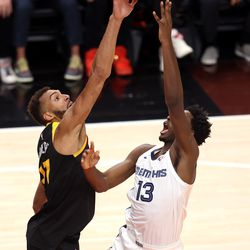 Utah Jazz center Rudy Gobert (27) blocks a shot by Memphis Grizzlies forward Jaren Jackson Jr. (13) as the Utah Jazz and Memphis Grizzlies play Game 2 of their NBA playoffs first round series at Vivint Arena in Salt Lake City on Wednesday, May 26, 2021. Utah won 141-129.