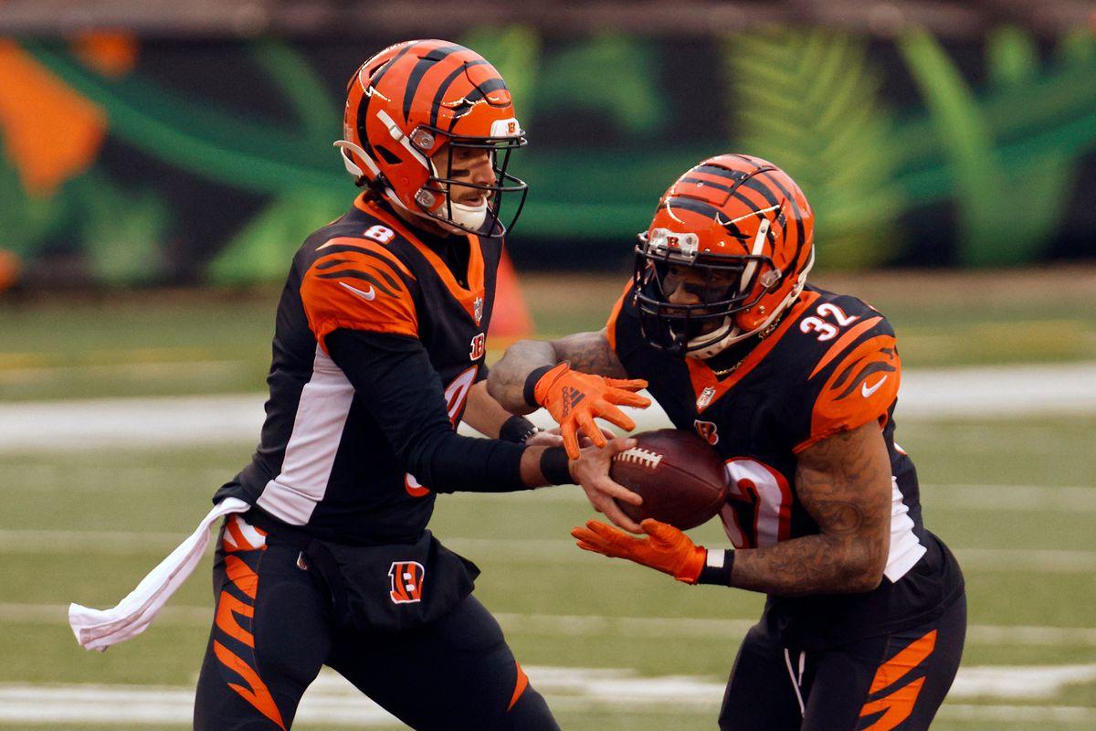 Brandon Allen #8 of the Cincinnati Bengals hands the ball off to Trayveon Williams #32 in the second quarter against the Dallas Cowboys at Paul Brown Stadium on December 13, 2020 in Cincinnati, Ohio.