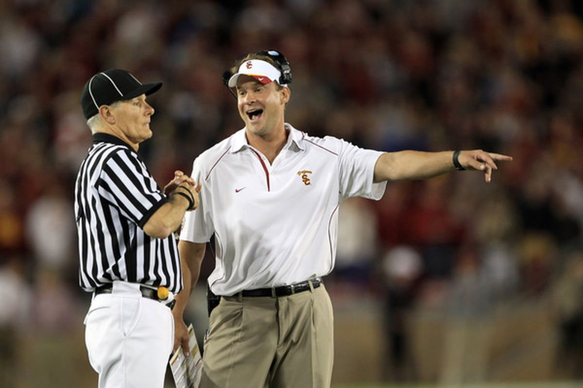 PALO ALTO, CA - OCTOBER 09:  USC Trojans head coach Lane Kiffin speaks with side judge Mike Weseloh during their loss to the Stanford Cardinal at Stanford Stadium on October 9, 2010 in Palo Alto, California.  (Photo by Ezra Shaw/Getty Images)