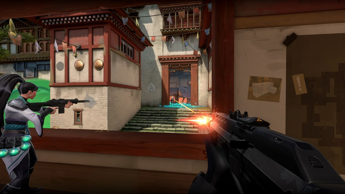 Valorant characters have a gun fight in a courtyard