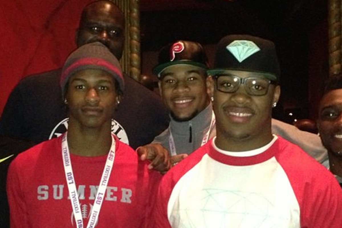 Shaquille O'Neal meets Robert Nkemdiche (Phillies hat) in LSU traveling party.