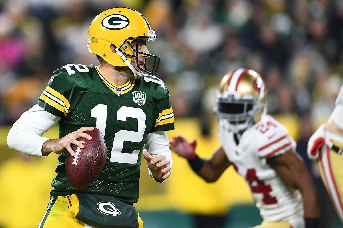 Green Bay Packers quarterback Aaron Rodgers drops back to pass