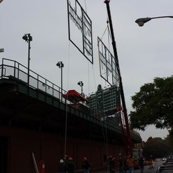 This was the closest they had the sign to the back wall of the bleachers