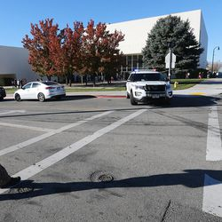 A Utah Highway Patrol trooper blocks the driveway at Mountain View High School in Orem after five students were stabbed in an apparent attack by a 16-year-old boy on Tuesday, Nov. 15, 2016.