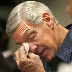 Utah Jazz coach Jerry Sloan wipes away a tear on Feb. 10, 2011 in Salt Lake City as he announces his resignation after being the head coach for the Jazz since 1988.