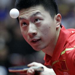 FILE - This April 1, 2012 file photo shows China's Ma Long serving the ball during the final of the World Team Table Tennis championships between China and Germany, in Dortmund, Germany. China owns table tennis like the United States once dominated men's basketball. It has won every gold medal in three Olympics, and four years ago in Beijing it finished 1-2-3 in both men's and women's singles, and swept gold in both team events.