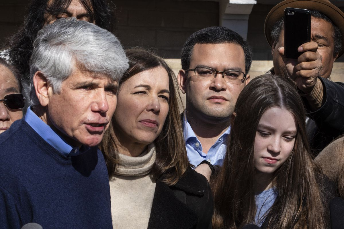 Mark Vargas, a political strategist and advisor, watches as former Illinois Gov. Rod Blagojevich speaks to reporters outside the family's Ravenswood Manor home the day after he was released from a Colorado prison, Wednesday afternoon, Feb. 19, 2020. President Donald Trump on Tuesday commuted Blagojevich's 14-year prison sentence on charges of public corruption.
