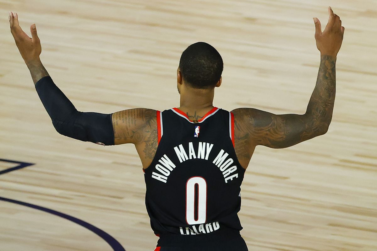 Damian Lillard of the Portland Trail Blazers calls for a foul against the Memphis Grizzlies during the fourth quarter in the Western Conference play-in game one at The Field House at ESPN Wide World Of Sports Complex on August 15, 2020 in Lake Buena Vista, Florida.