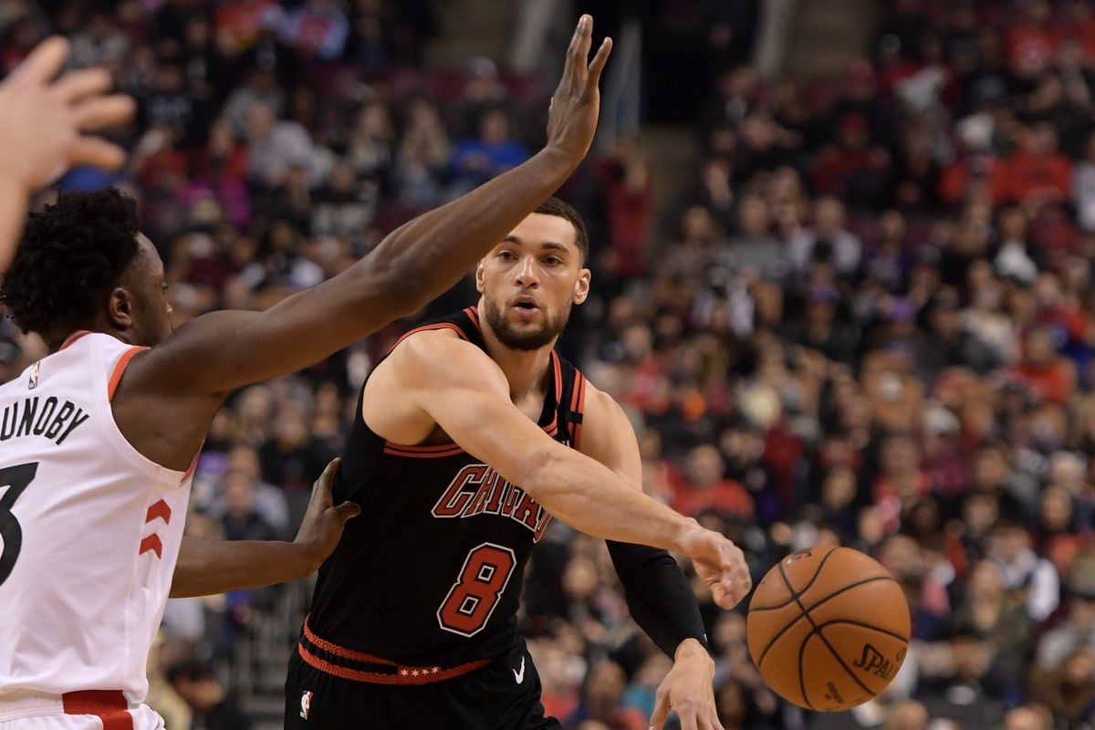 Chicago Bulls guard Zach LaVine passes the ball past Toronto Raptors forward OG Anunoby in the first half at Scotiabank Arena.
