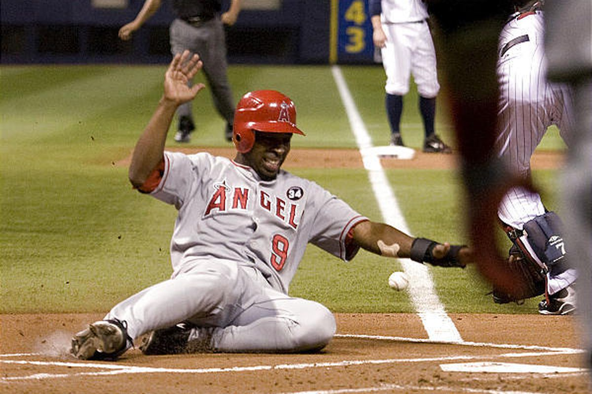 Los Angeles Angel Chone Figgins slides in with a run against the Minnesota Twins.  starting pitcher Nick Blackburn during a baseball game in Minneapolis on Friday.
