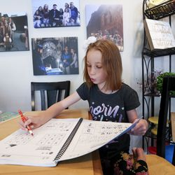Rebekah Hilton, 7, works on her Chinese language skills from a workbook in her home in Orem on Thursday, June 25, 2020. Rebekah and four of her siblings attend dual language immersion schools.