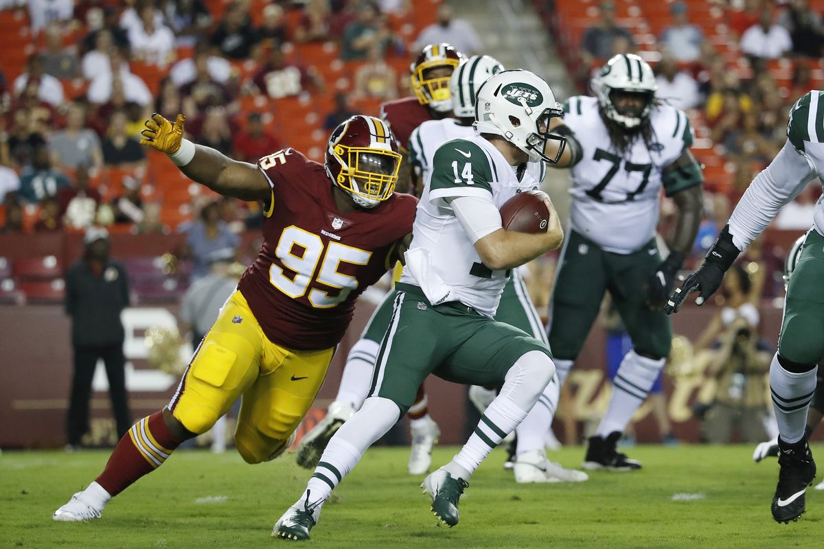 Washington defensive tackle Da'Ron Payne sacks quarterback Sam Darnold of the New York Jets in the first quarter of a preseason game at FedExField on August 16, 2018 in Landover, Maryland.