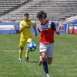 Johan Gomez (9) chasing a long ball during the opening match of the 40th Annual Dallas Cup.