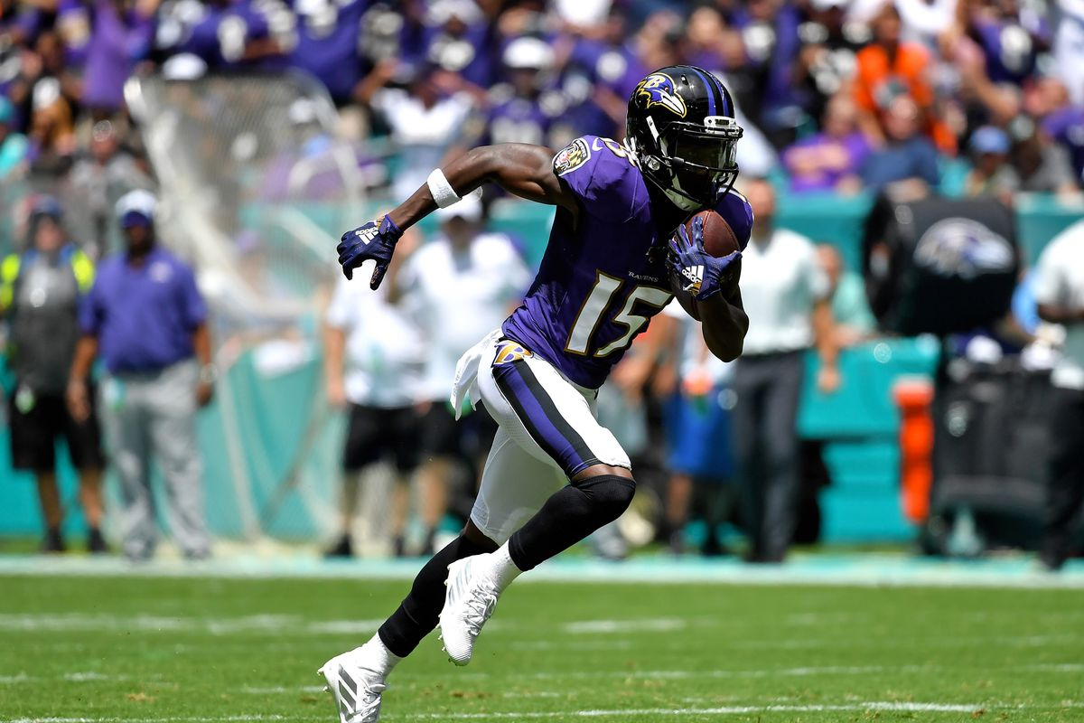 Baltimore Ravens wide receiver Marquise Brown carries the ball against the Miami Dolphins during the first half at Hard Rock Stadium.