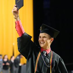 Noah Kelsch holds up his degree during Salt Lake Community College's commencement ceremony at the Maverik Center in West Valley City on Friday, May 6, 2016.
