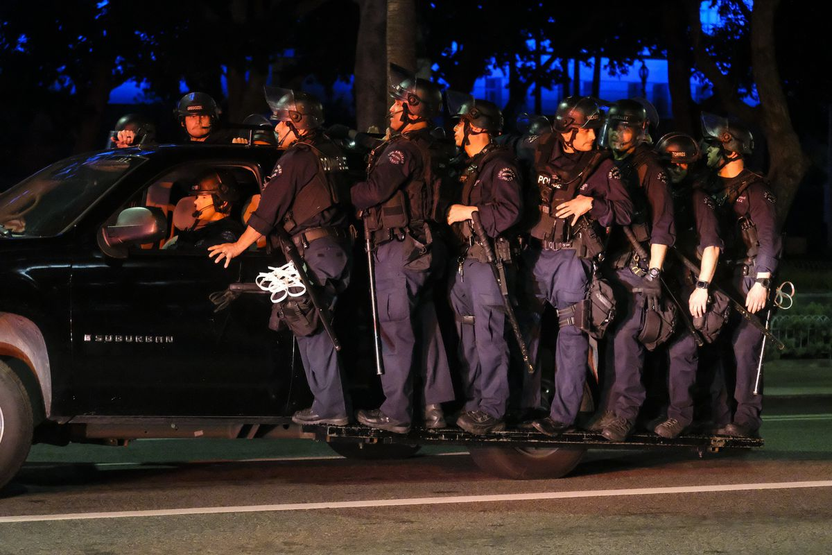 LAPD riot police stand by outside City Hall during a protest of the death of George Floyd, a black man who was in police custody in Minneapolis, in downtown Los Angeles, Wednesday, May 27, 2020.